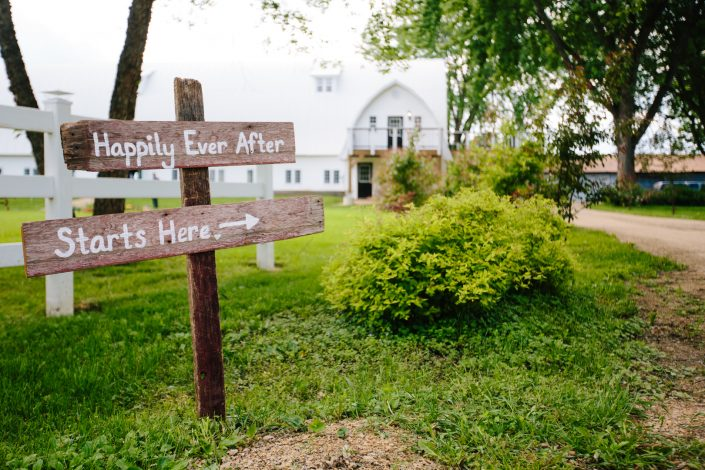 Happily ever after sign in front of Minnesota Rustic Barn Wedding Venue